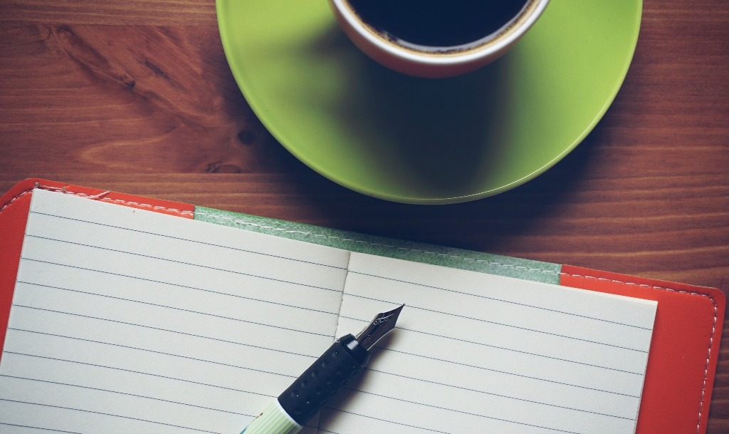 Coffee and notebook ready for Breakfast meetings at The Workstation