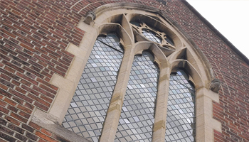 Exterior of gothic arched window and original features of Arquen House Business Centre in St Albans.