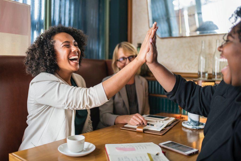 Women collaboration meeting - high five