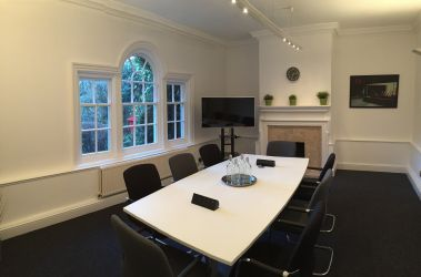 Meeting room in Beaconsfield business centre with seating for 8, flatscreen TV and WiFi.